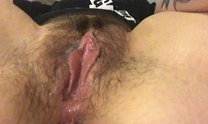 Rub my unshaved love button and receive my fingers soaked