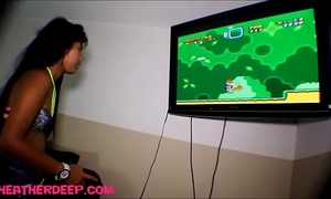 Heather unfathomable playing super mario brother receives deepthroat throatpie