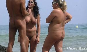 Nudist beach voyeur discharges bare sweethearts sunbathing
