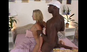 Hot blond screwed by a large dark schlong for interracial pleasure