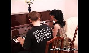 Mature lewd piano trainer fucking her student