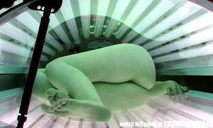 Hidden camera in public tanning couch