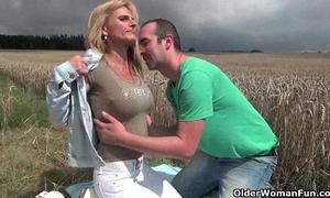 Sexy senior slutwife with large milk sacks receives screwed outdoors
