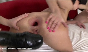 Alisya has her butthole gaped by allies with biggest dong dildos