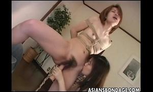 Cute oriental playgirl tormented by her smokin' sexy dominatrix-bitch