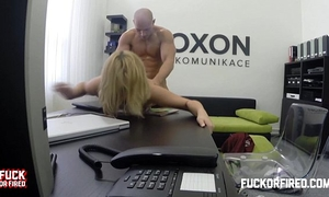 Horny blond secretary copulates her boss in the office
