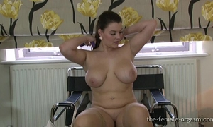 Curvaceous large breasted babe masturbates to a real big O