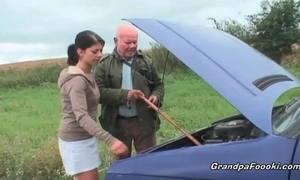 Cute chick seduces grand-dad on the road