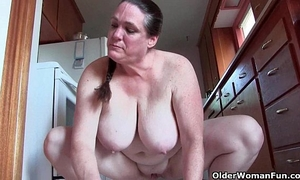 Granny with large pantoons cleaning the kitchen nude