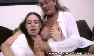 Mature milf in threesome tugging cock for this favourable man