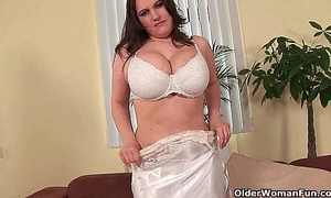 Soccer mommy with natural large wobblers bonks herself with a sex-toy