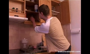 Mature mommy and juvenile man on the kitchen
