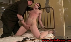 Tied up sub with gag getting whipped by her dominant