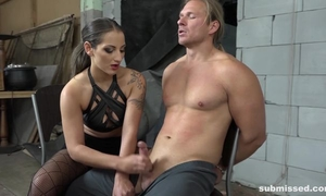 Dominant brunette playing with slaveboy's dick