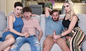 Two slutty MILFs swap their sons and get fucked in the living room
