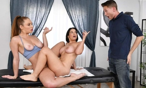 Pair of juicy bitches getting fucked on the massage table