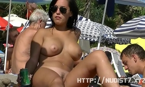 Sexy nudist hotties are captured on camera on a beach