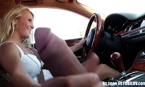 Girlfriend gives tugjob during the time that driving